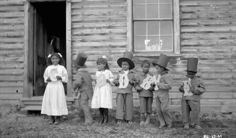 "Children_at_Fort_Simpson_Indian_Residential_School_holding_letters_that_spell_""Goodbye,""_Fort_Simpson"